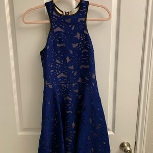 Blue dress with lace detailing and black trim